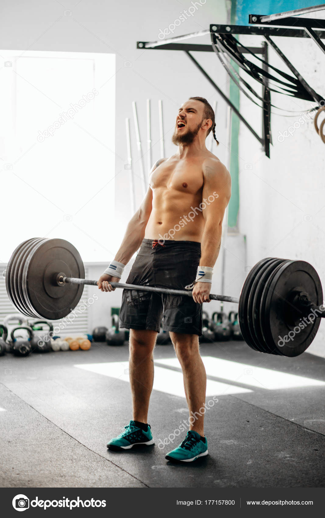 72b2323d2a5e Man lifting weights. muscular man workout in gym doing exercises with  barbell — Stock Photo