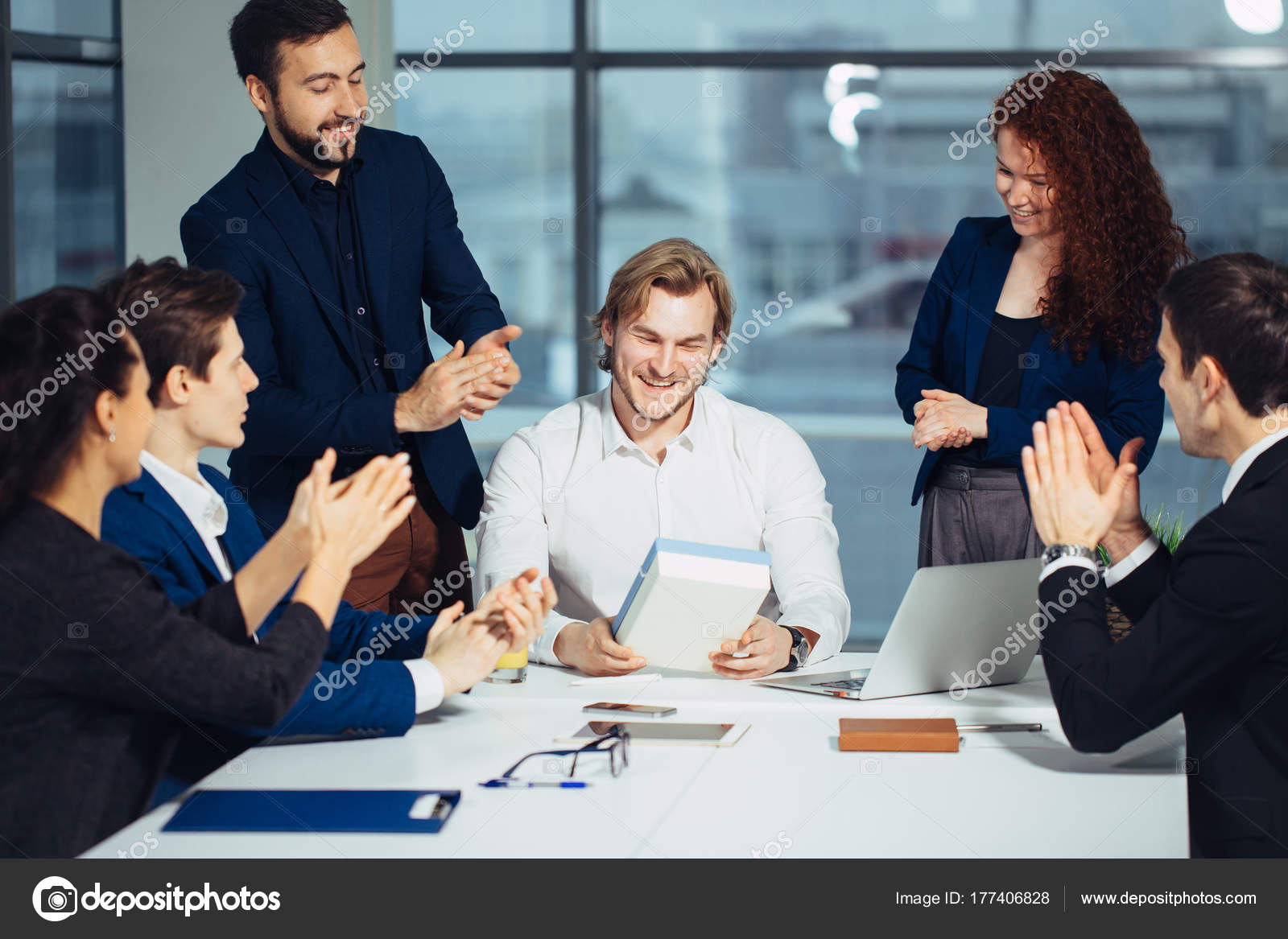 Colleagues Celebrating Bday Party In Office Smiling Giving Presents To Boss Stock Image