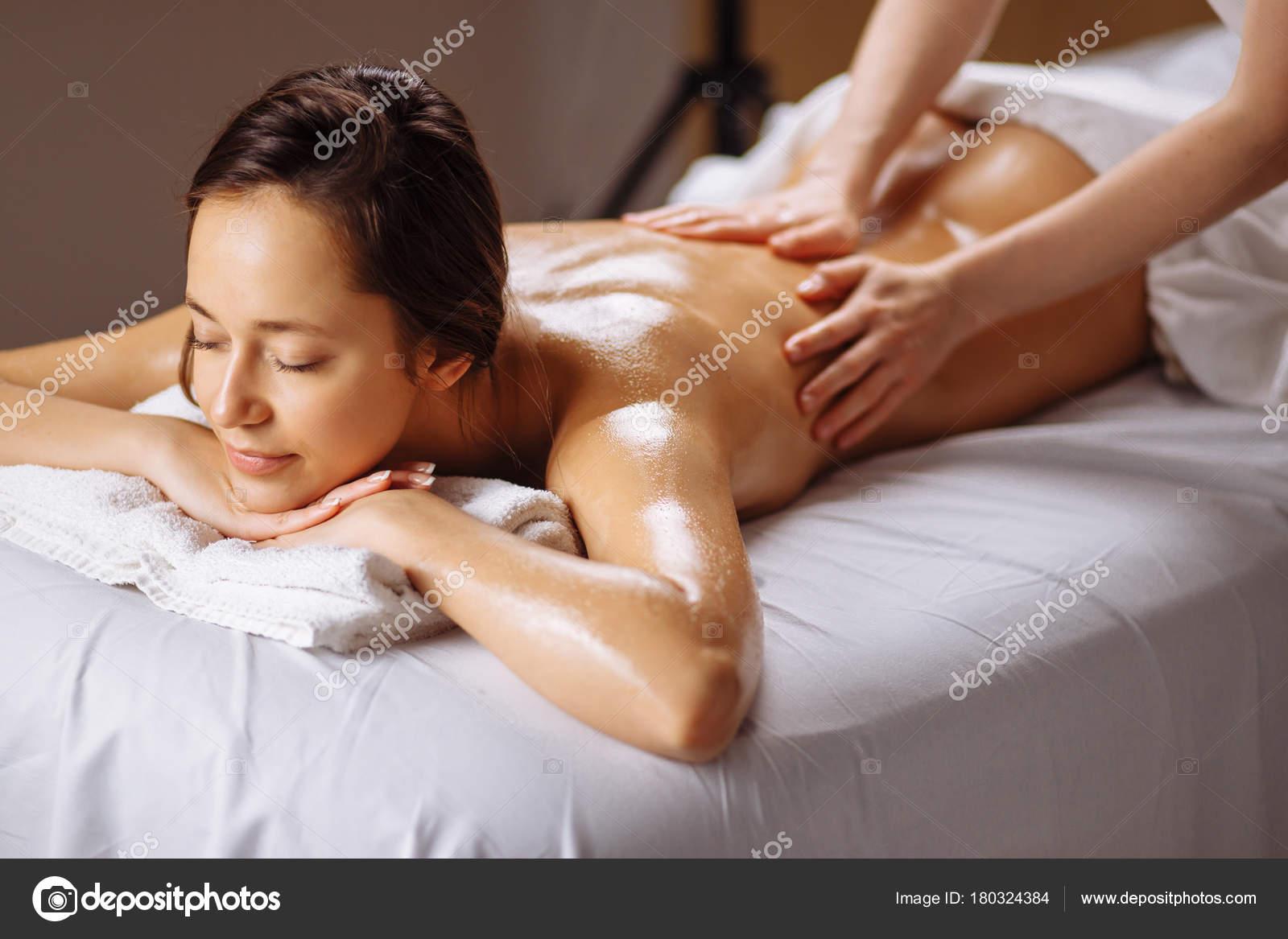 spa body massage treatment. woman having massage in spa salon
