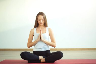 woman practicing yoga, sitting in Padmasana, exercise, Lotus pose, namaste