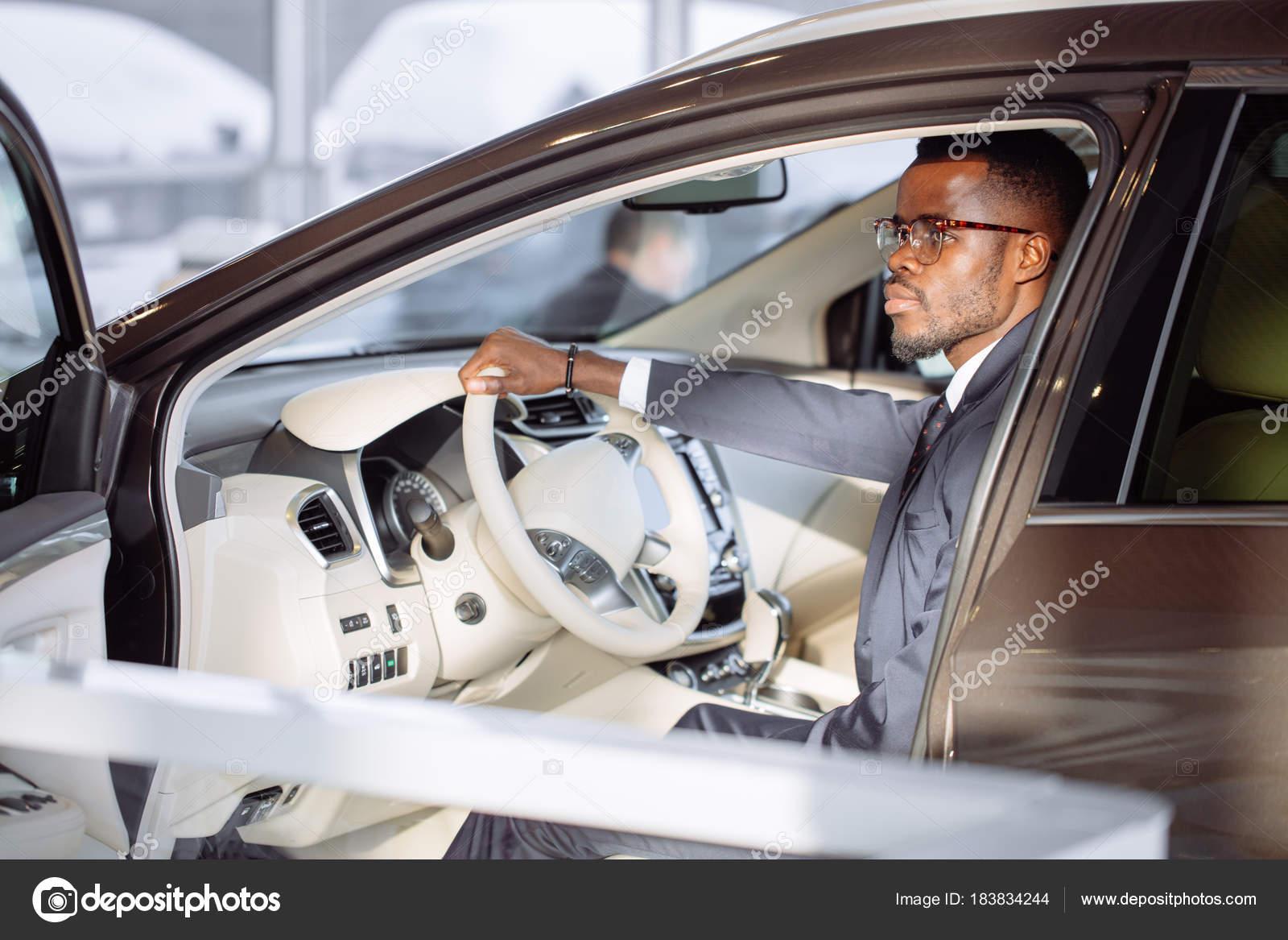 Stylish black man in car — Stock Photo © ufabizphoto #183834244