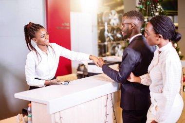 Customer buying a vehicle at car dealership. woman and man handshaking