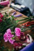 Photo table with flowers and garden tools at shop