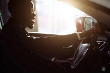 Stylish black man in car