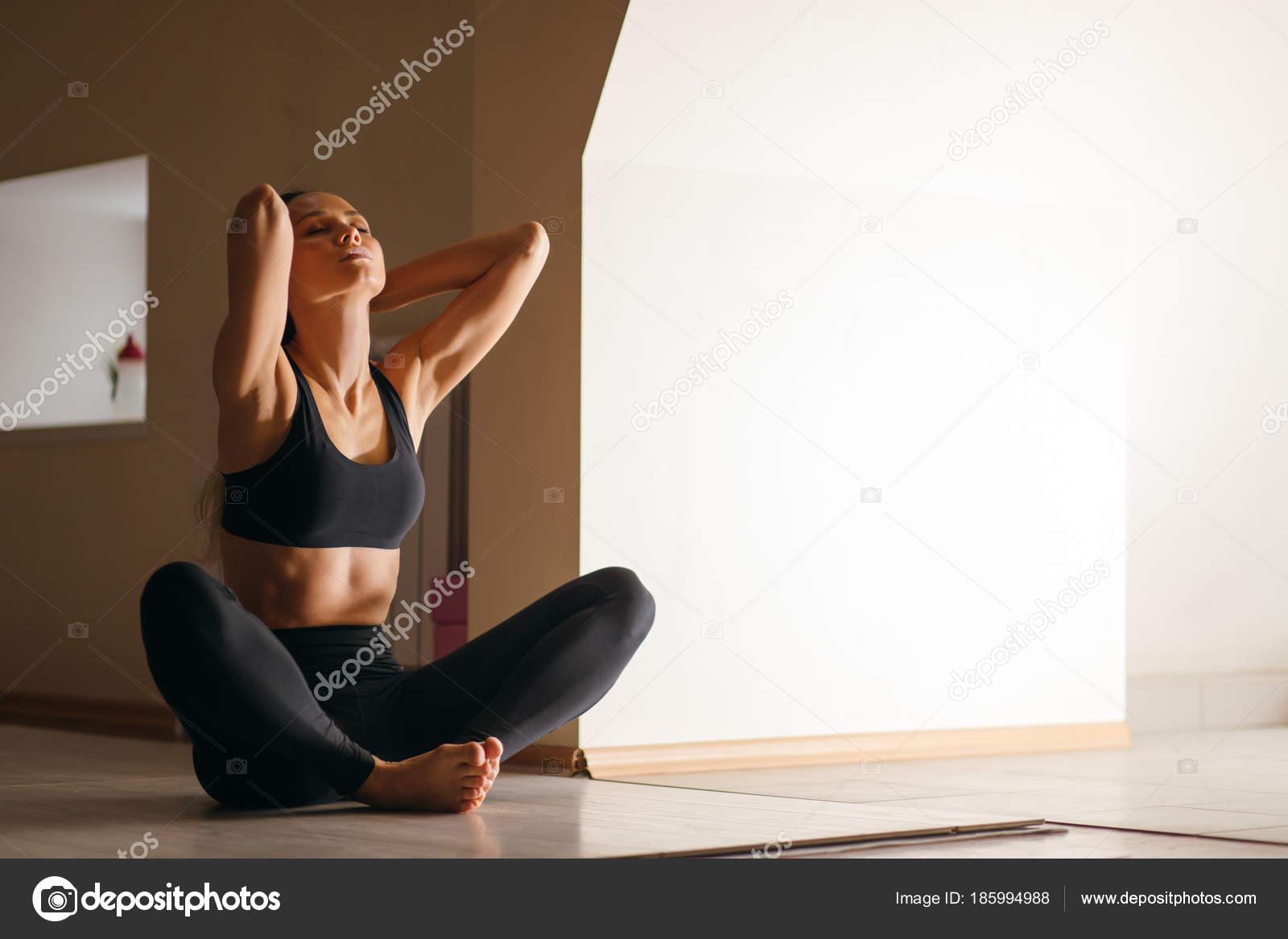 Woman Doing Yoga Exercise Sitting In Baddha Konasana Butterfly Pose Stock Photo