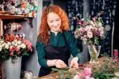 Photo nice florist wearing black apron collecting natural,coloful flowers