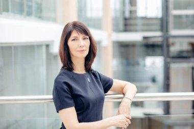 Businesswoman Standing in modern office