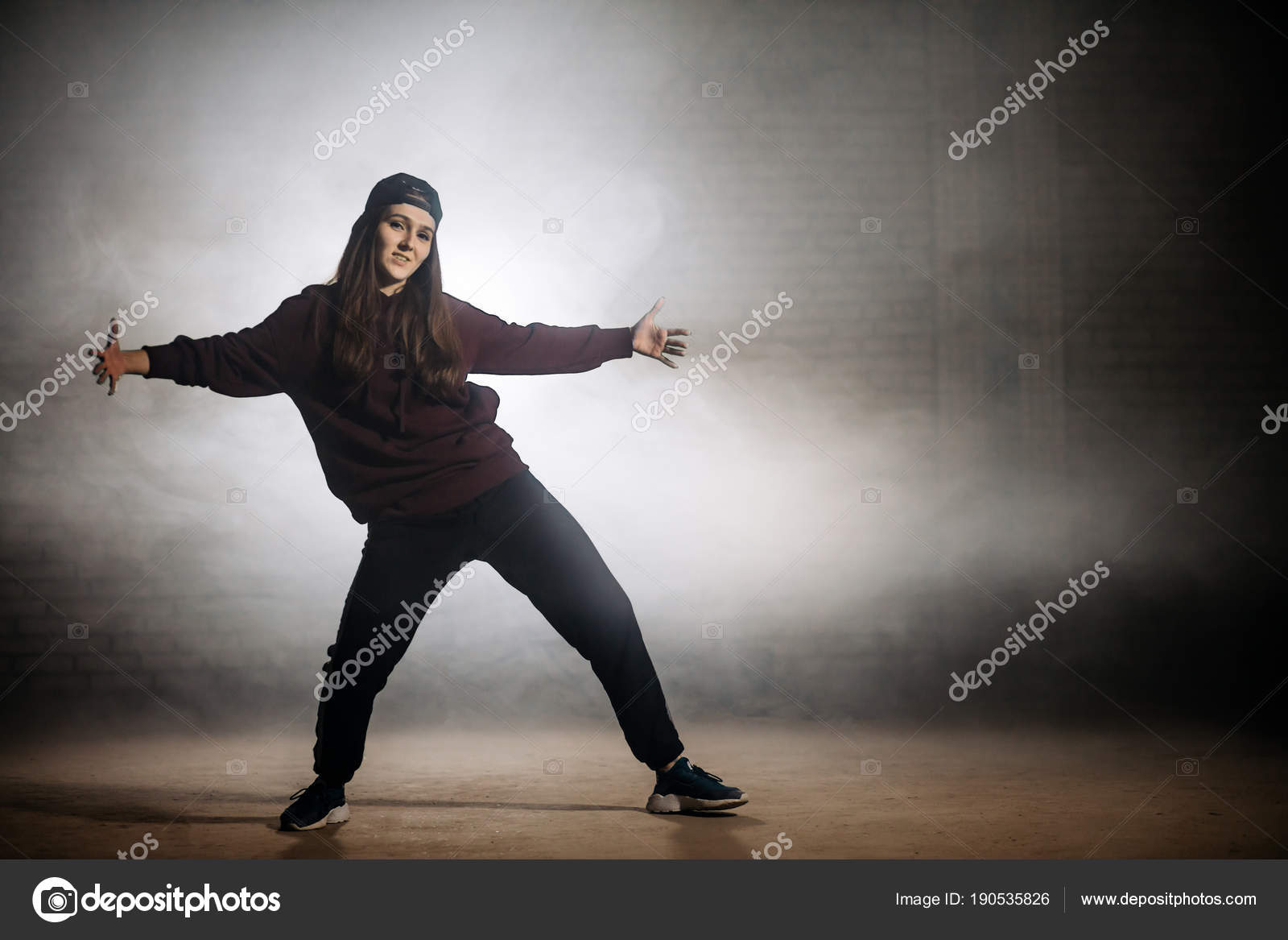 young woman practising movements with legs spread wide and open