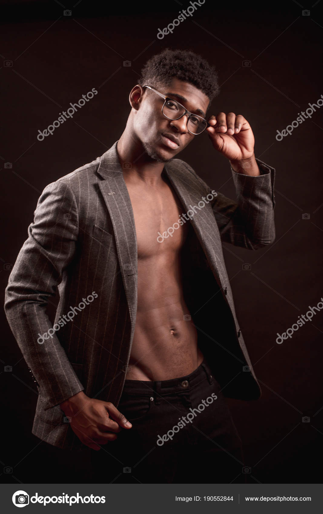 efd6bc6ca23 Slim sexy Afro american guy with glasses wearing stylish coat and black  trousers — Stock Photo