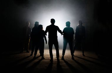 man teaching his friends hip hop on the dark studio
