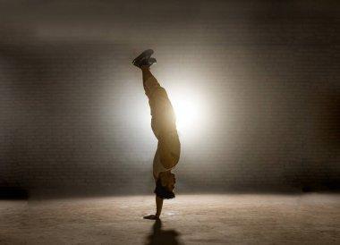 guy standing head over heels in balance-intensive position