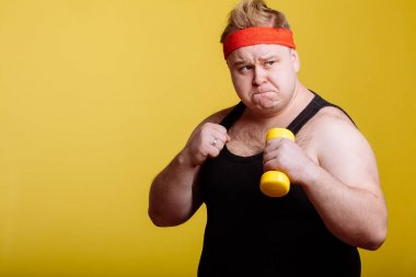 Fat man boxing and looking camera