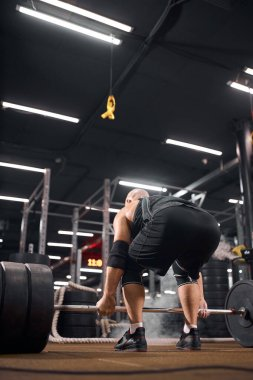 Strong powerlifter in gym