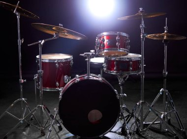 drums set isolated over dark room with