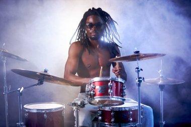 portrait of vigorous african man drummer