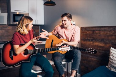 having conversation after playing guitar at home