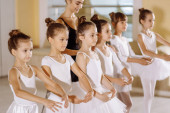 cute awesome kids 7-8 yars old dance classic ballet together