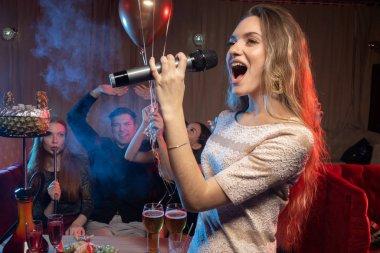 beautiful woman emotionally sing in karaoke