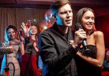young caucasian couple in karaoke club