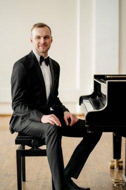 professional pianist man sit posing at camera