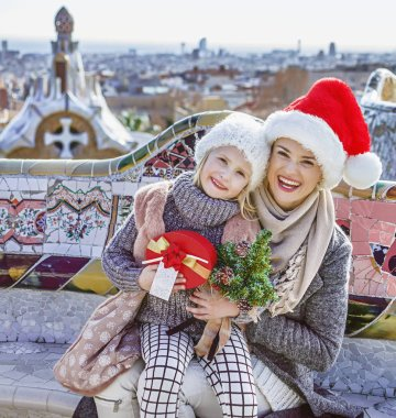 happy mother and child at Guell Park in Barcelona at Christmas