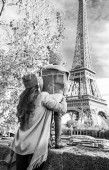 Fotografie Seen from behind mother and child travelers on embankment in Paris, France looking on Eiffel Tower
