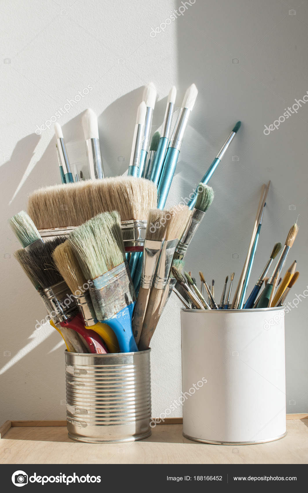 Bunch Different Types Paint Brushes Placed Cans White Wall