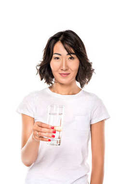 Attractive smiling asian woman with glass on water, isolated on white stock vector