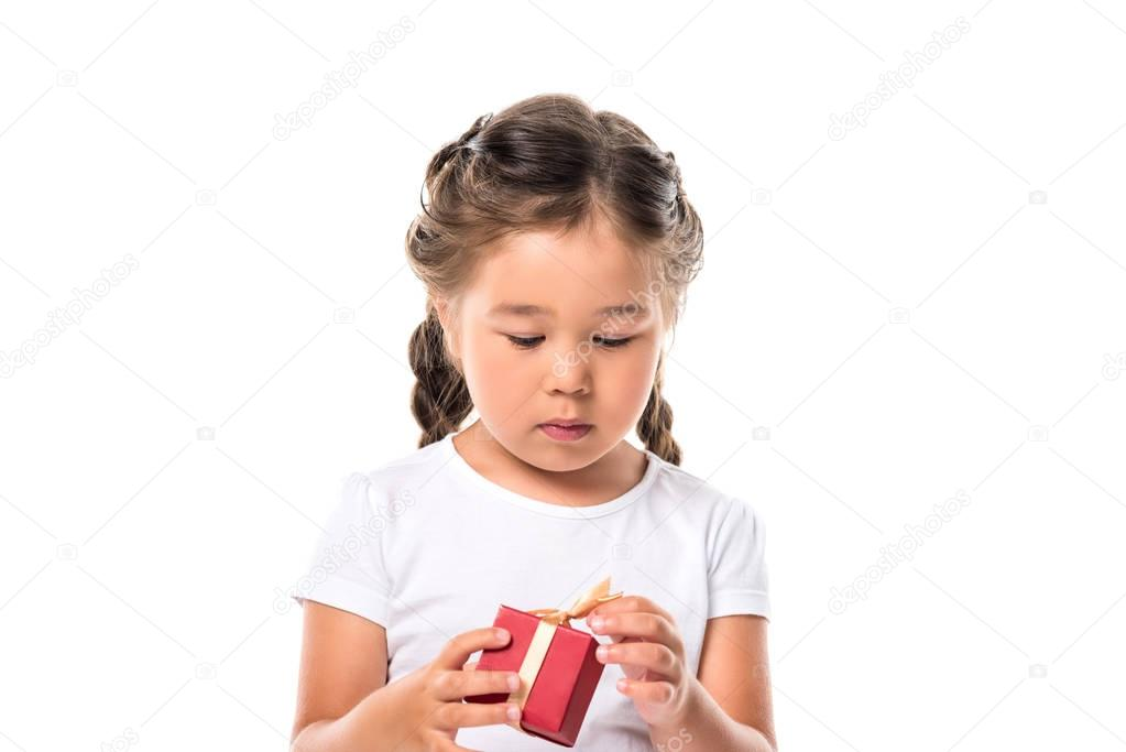 child with red gift box