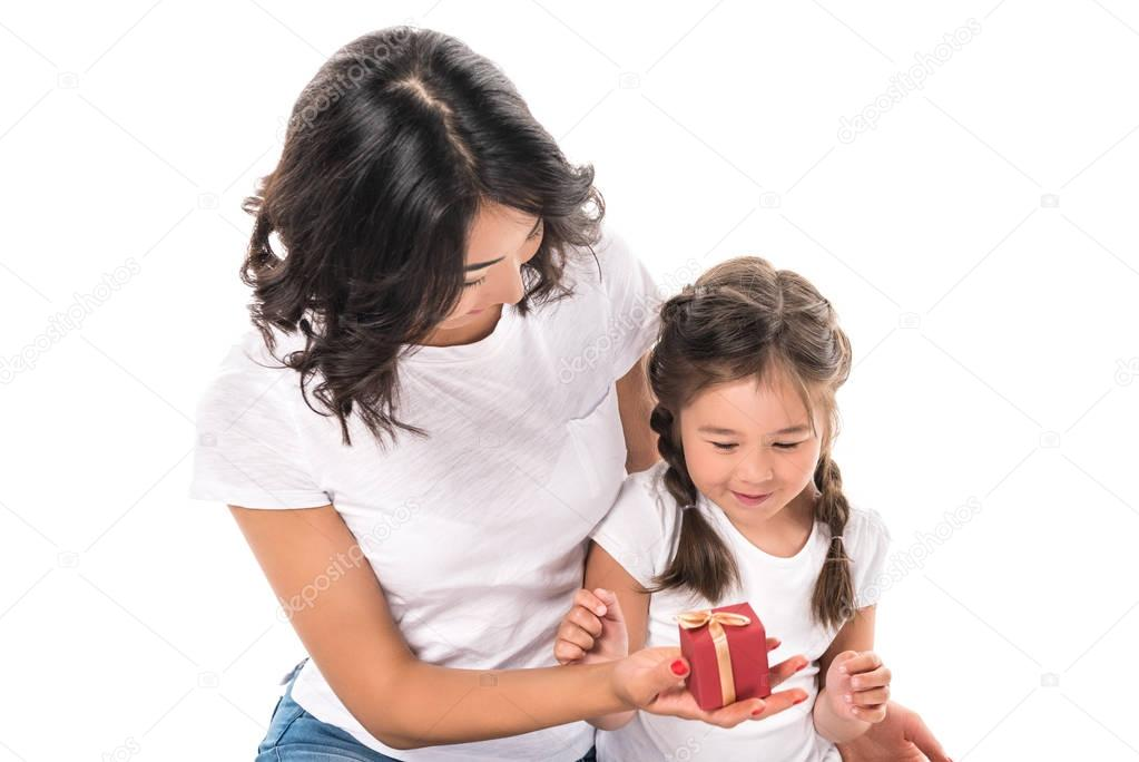 mother and daughter with gift box