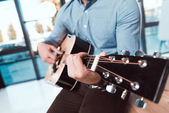Fotografie businessman with guitar in office