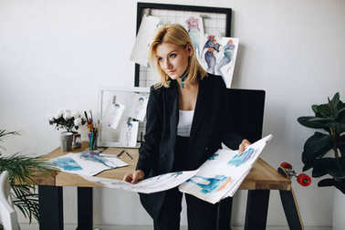 Young fashion designer with sketches