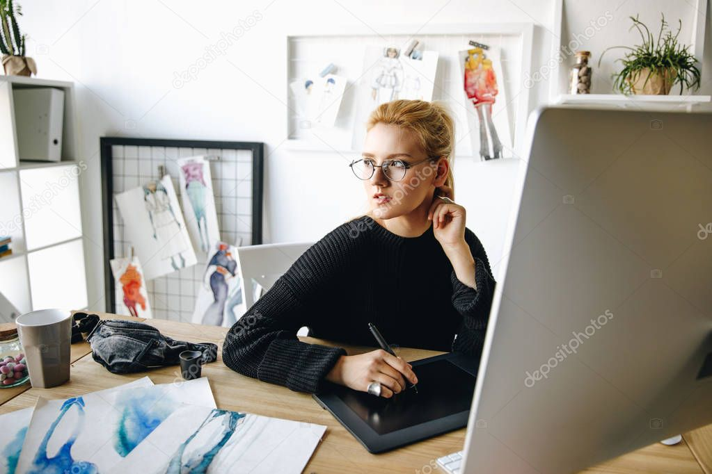 fashion designer working with devices