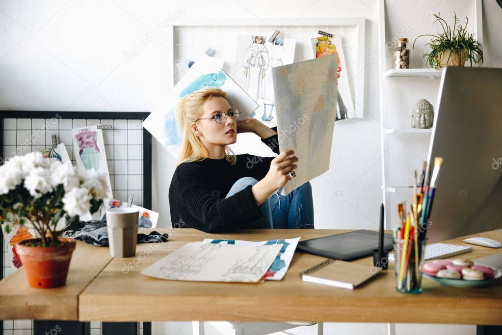 designer with sketches at workplace