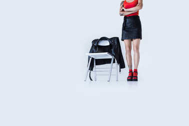 fashionable girl standing at chair