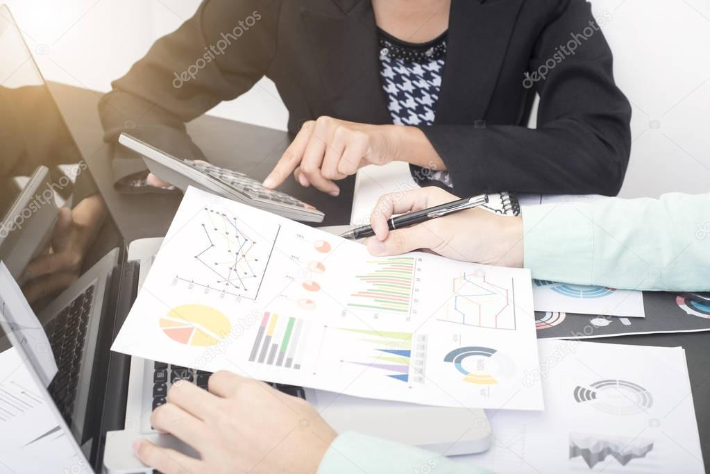 business accountants with documents graph financial on office