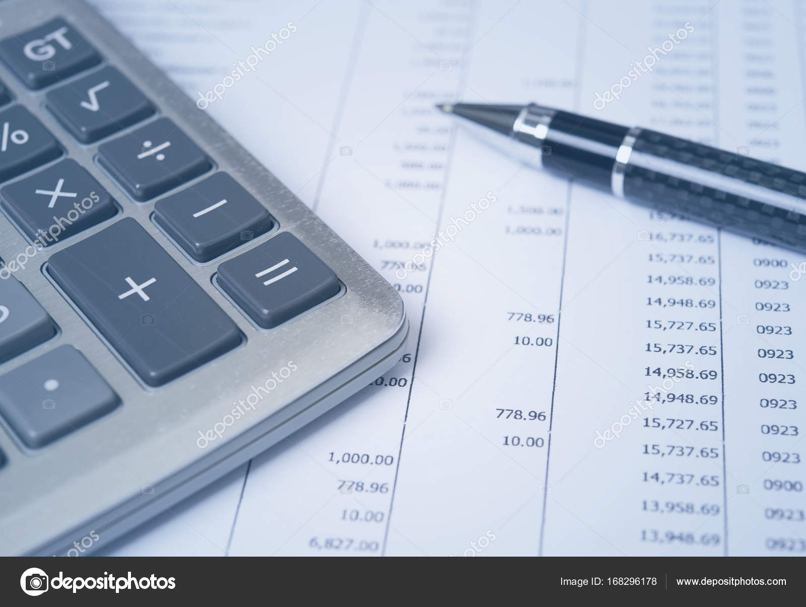calculator with pen on finance report stock photo baramee2017