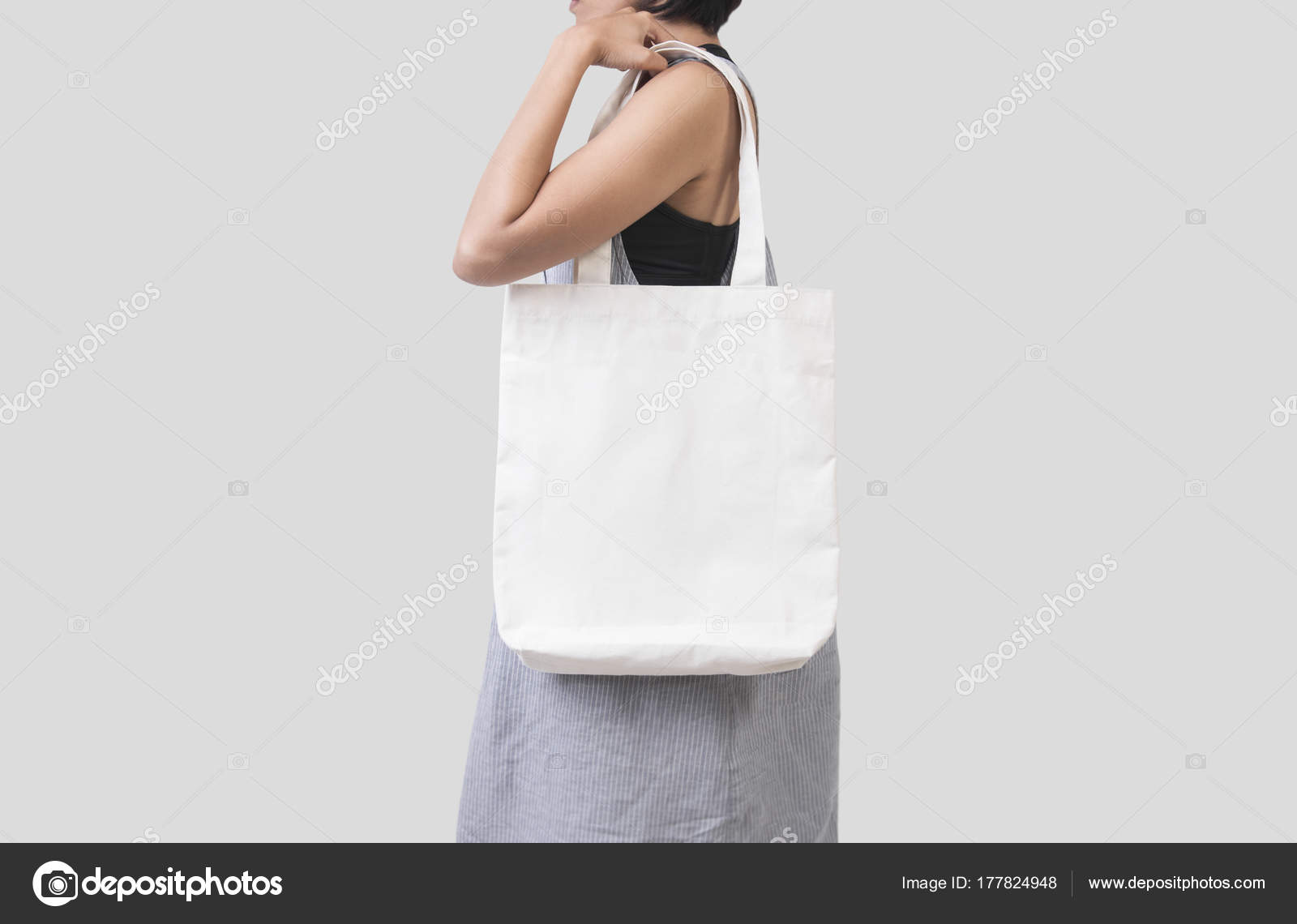 girl is holding bag canvas fabric for mockup blank template stock