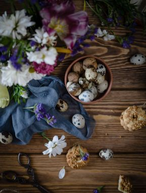 Quail eggs, walnuts in bowl and cookies