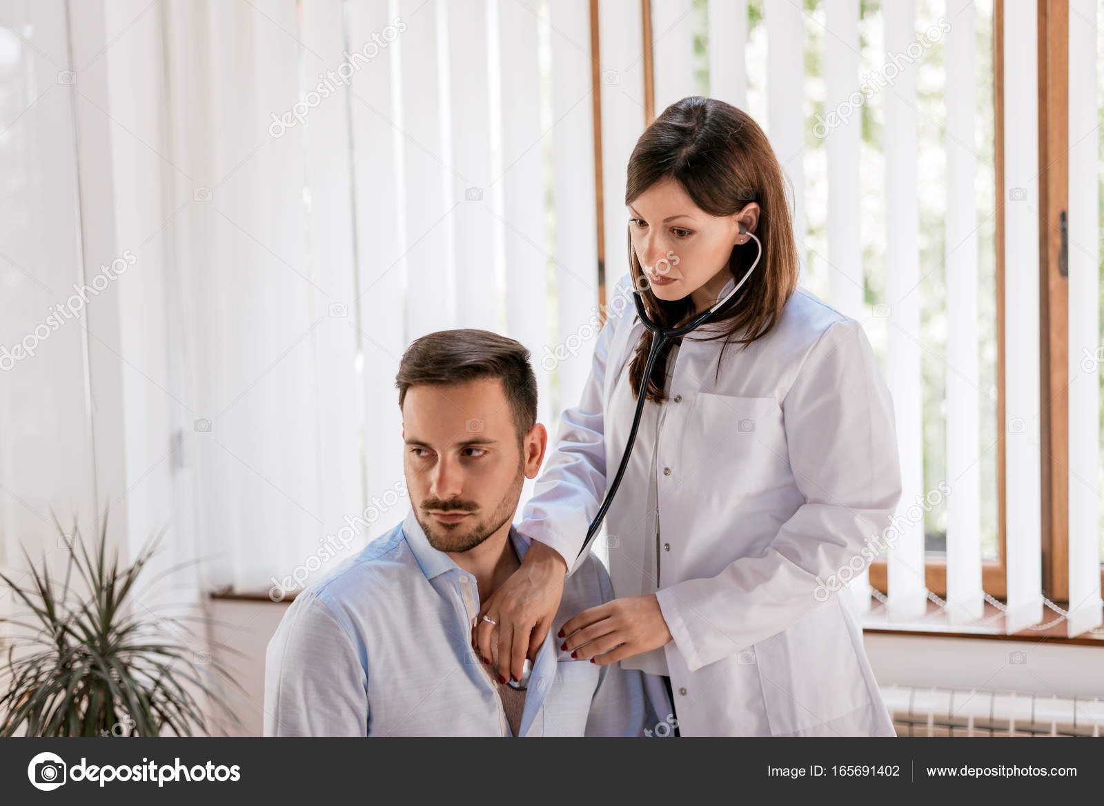 Good interlocutors listening to adult female heart beat with stethoscope