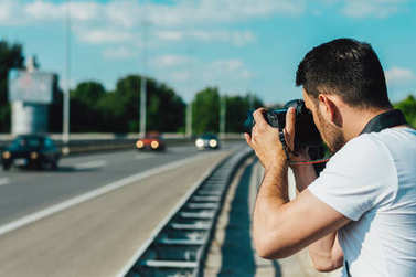 Man photographing cars