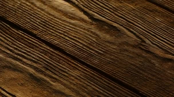 A wooden table top with a texture.