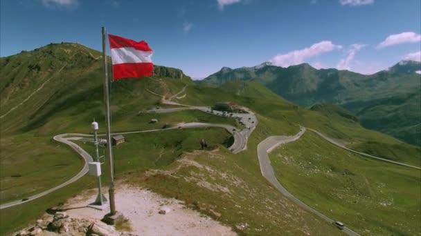 Austrian flag on the top of Grossglockner mountain pass