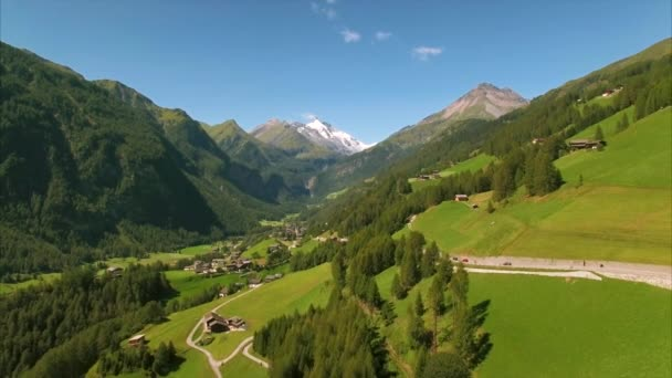 Green village of Heiligenblut in the Alps, aerial footage