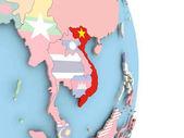 Vietnam s vlajkou na zeměkouli