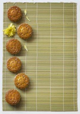 Mid-autumn festival moon cakes on bamboo mat.