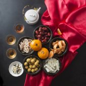 Flat lay Chinese new year food and drink and decoration items. Text appear in image: Prosperity.