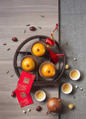 Fotografie Flat lay Chinese new year food and drink and decoration items. Text appear in text: Prosperity.