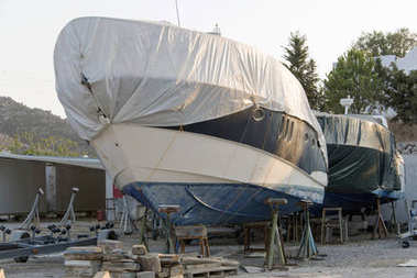 A covered boat in the shipyard