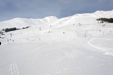 People skiing in the snow ski piste in the alps switzerland for winter holidays